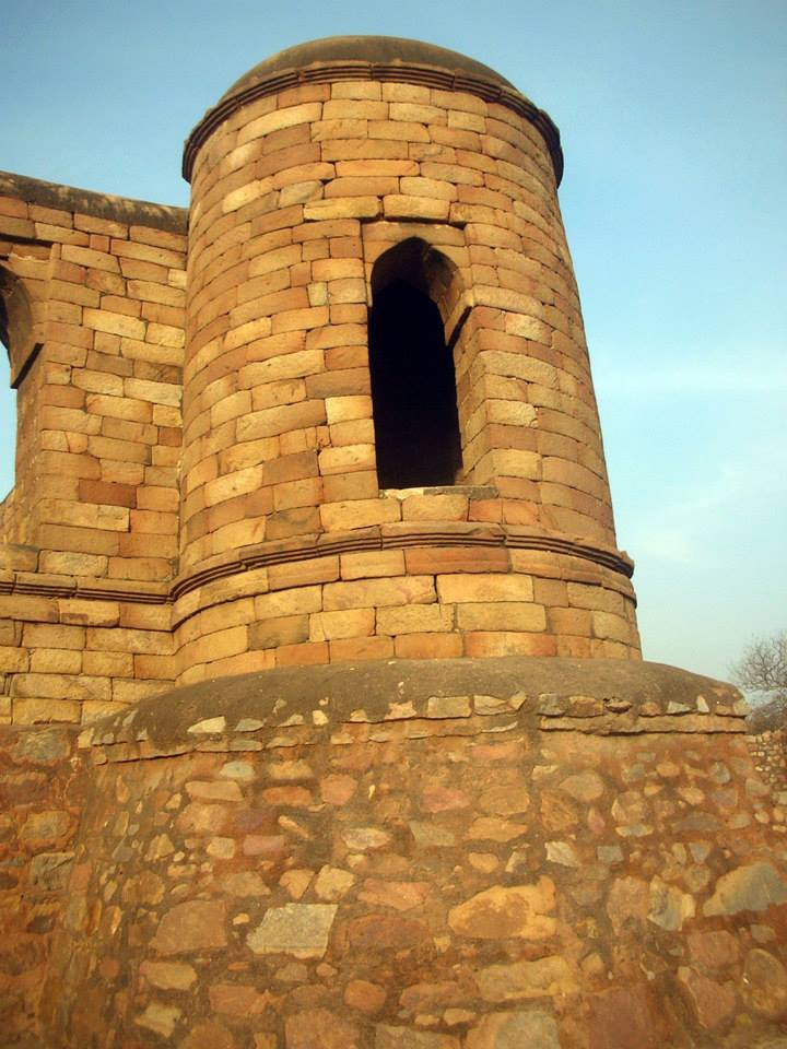 A corner turret punctured by a corbelled 'false' arch.