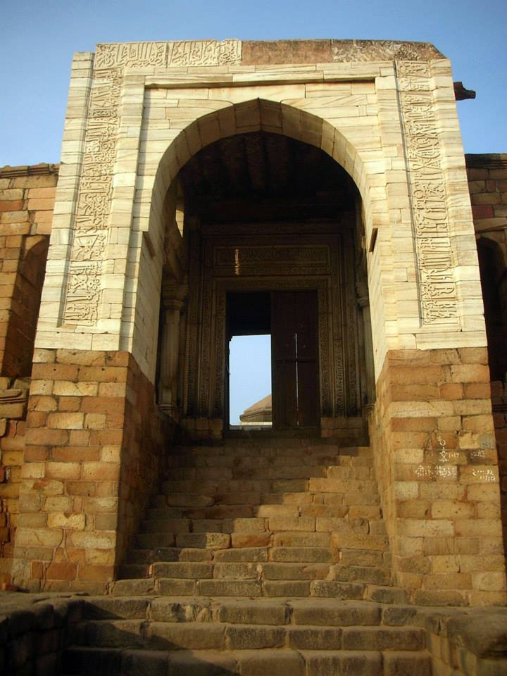The imposing entrance archway, with the flight of steps leading up to the central court.