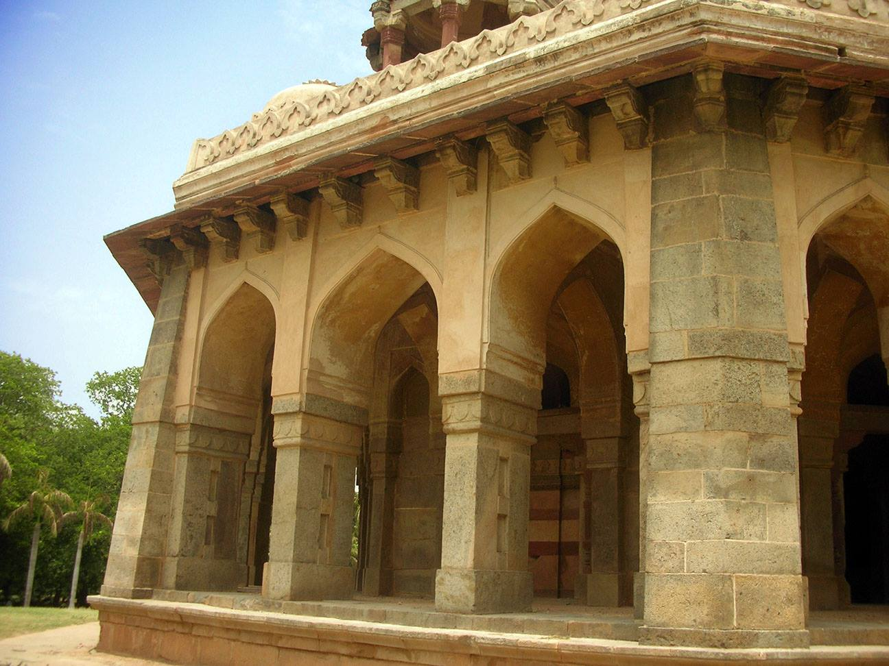 Each facade is pierced by three identical arches, with each external angle of the tomb being reinforced by sloping buttresses.